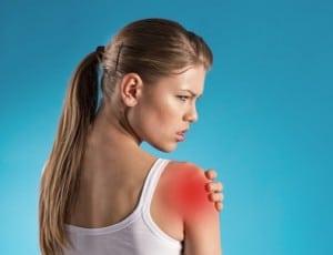 Young female patient having shoulder pain